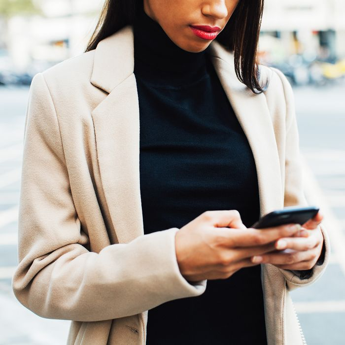 Girl Looking at Phone While Walking