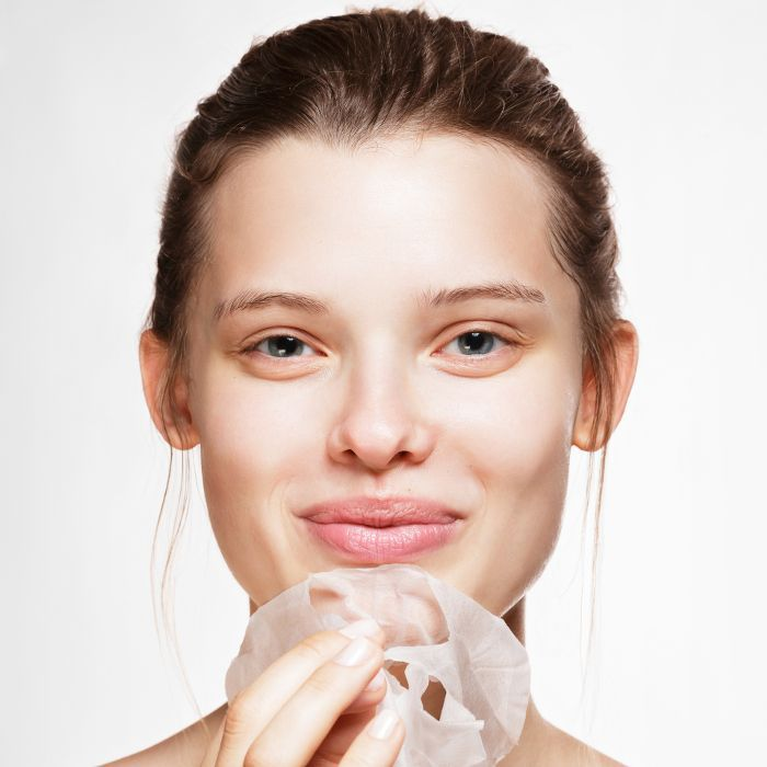 woman with clear skin and face mask