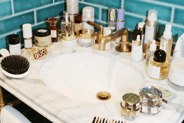 Beauty products scattered on bathroom counter