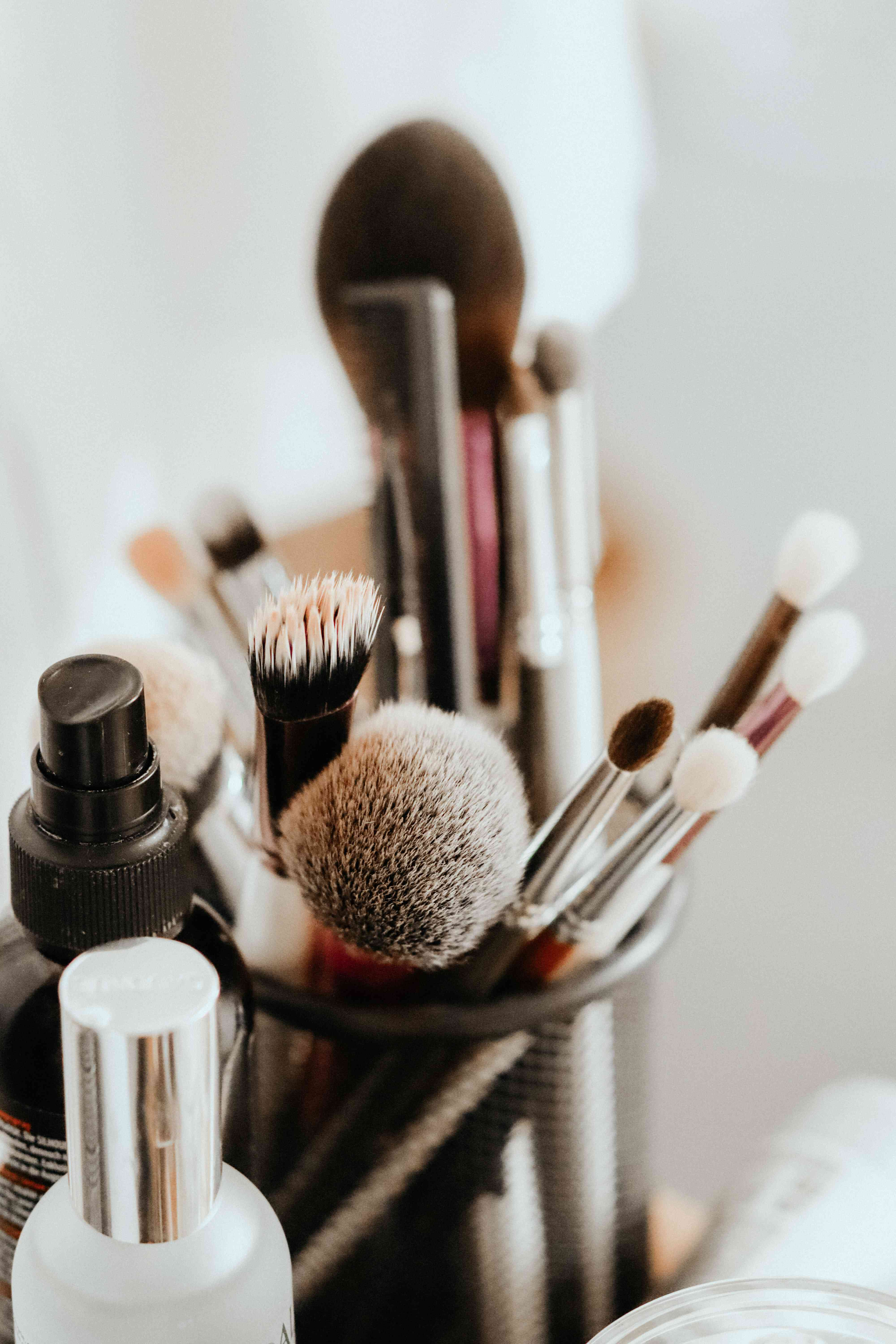 cup of makeup brushes