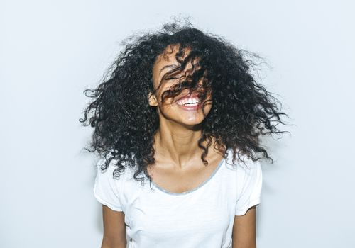 woman flipping curly hair