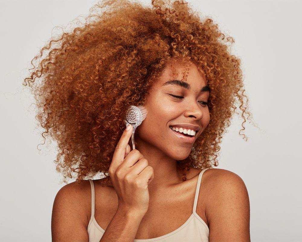 black femme exfoliates skin