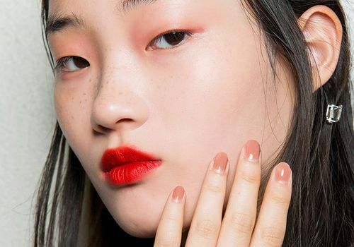 woman with clear skin and red lipstick
