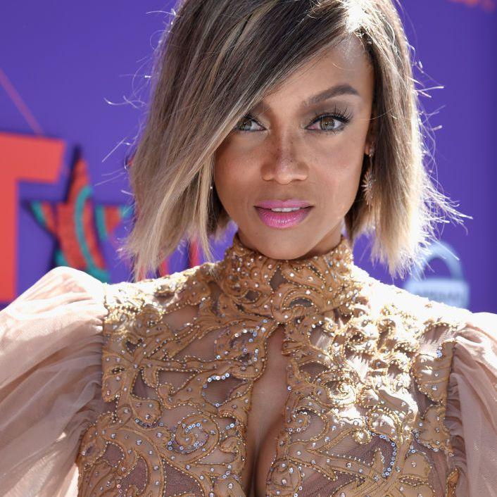 Tyra Banks bob with side-swept bangs