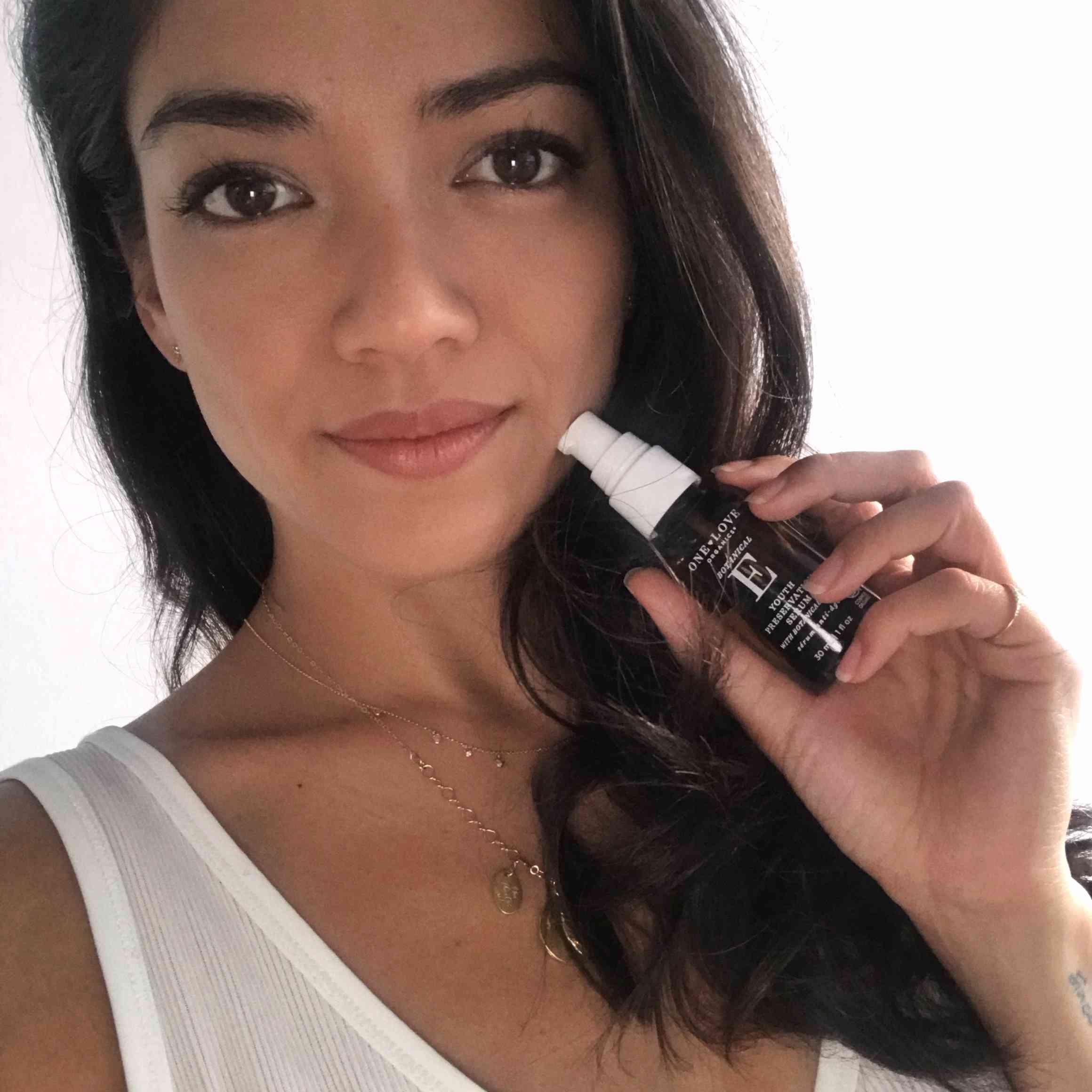 girl holding One Love Organics serum