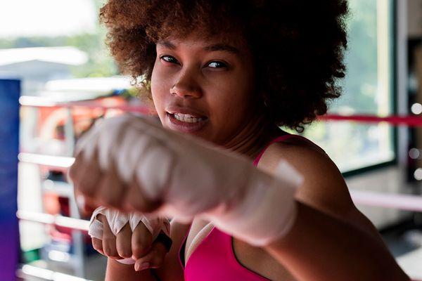 person boxing toward camera