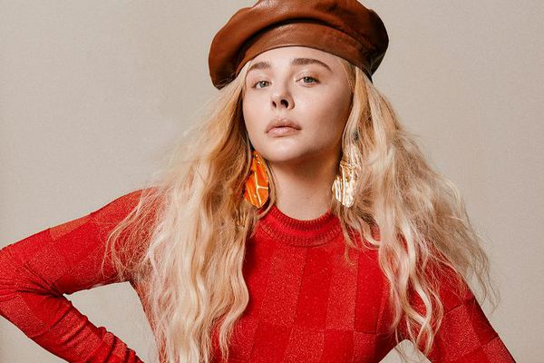 chloe grace moretz in red sweater and hat