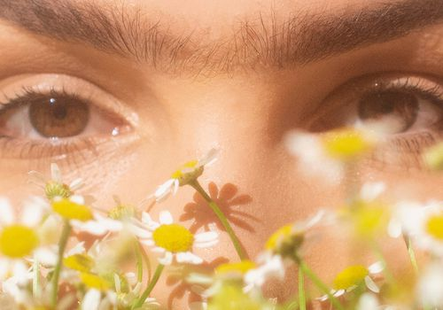 Closeup face with chamomile flowers