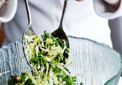woman mixing salad