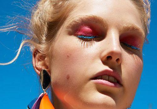 model wearing pink eye shadow and blue mascara