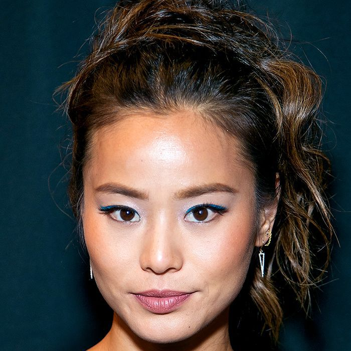 Jamie Chung wearing a high messy ponytail