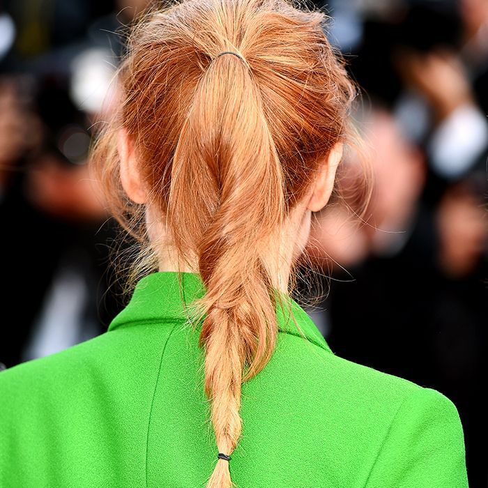 Jessican Chastain wearing her hair in a braided messy ponytail