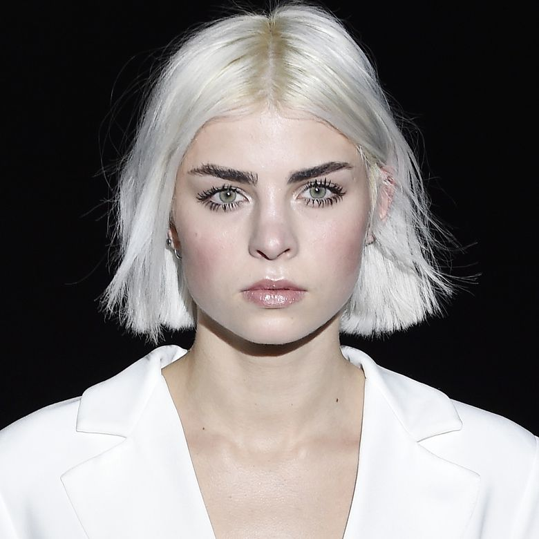 Model with smooth blonde bob