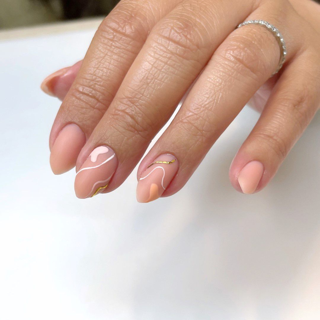 Person with matte abstract nail art