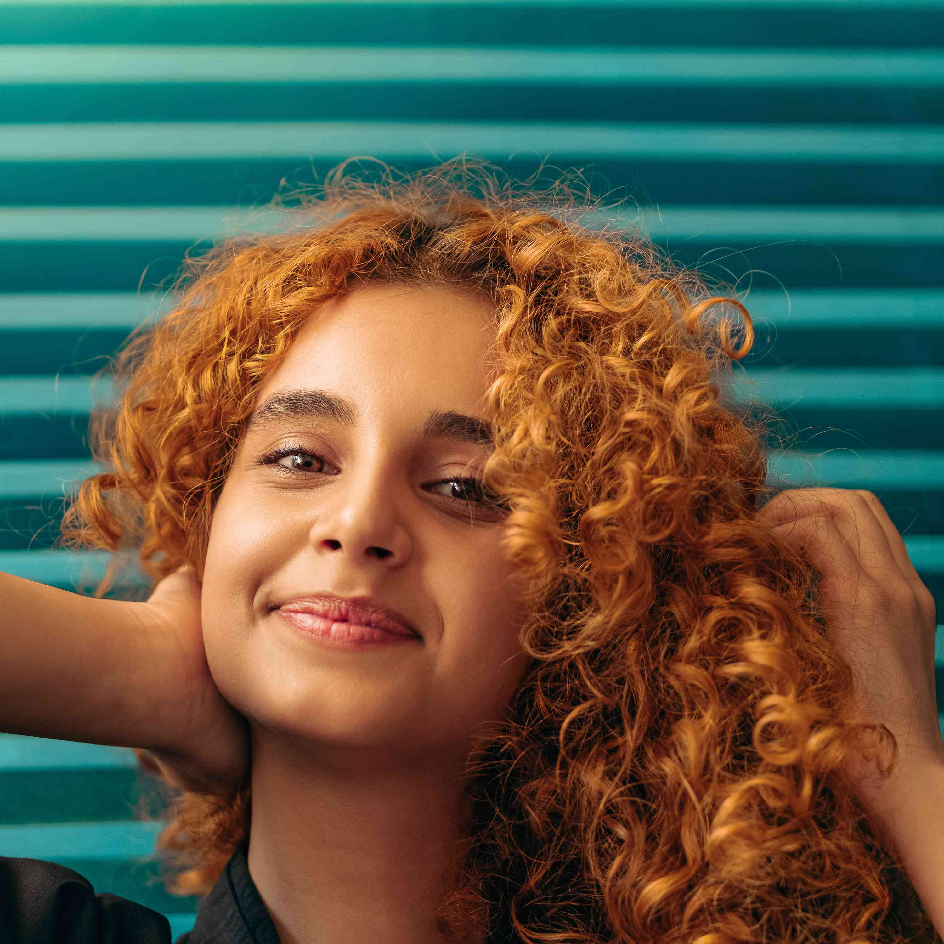 woman with curly red hair