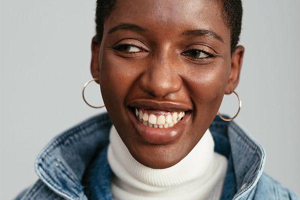 black femme smiling