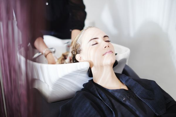 Woman getting hair washed in a salon