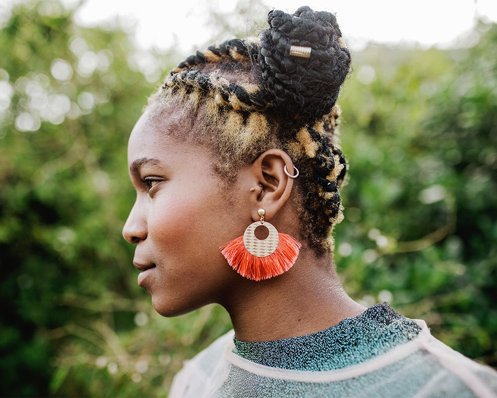young woman with ear piercings in profile