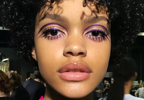 woman with purple eye makeup
