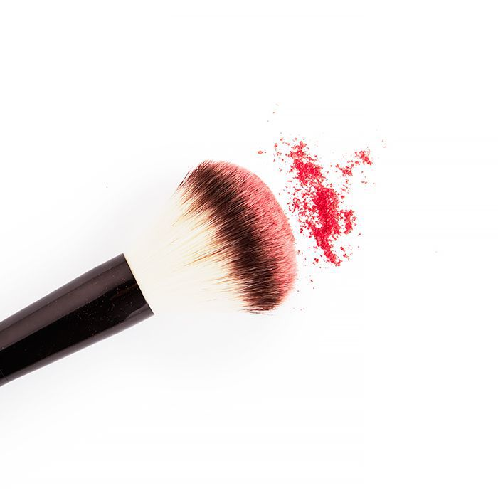 Makeup brush with red powder coming off