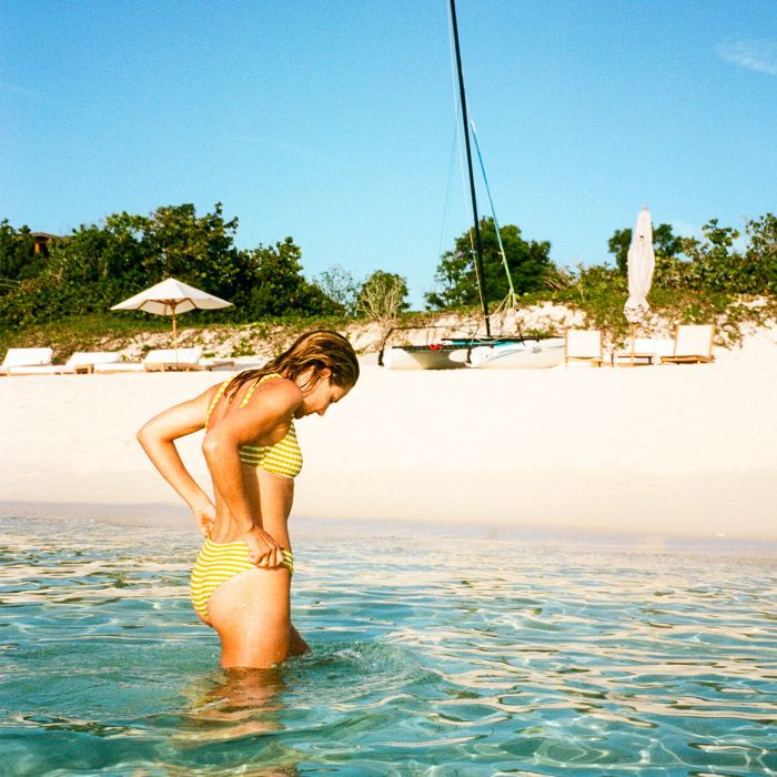 summer holiday beauty essentials: Lucy Williams in the sea