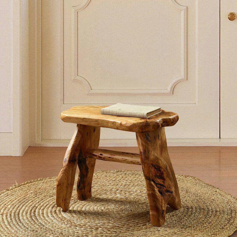 A burl wood bath stool, currently for sale at Wayfair