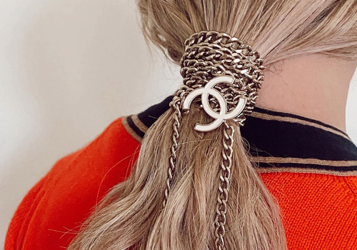 woman with chanel chains in ponytail