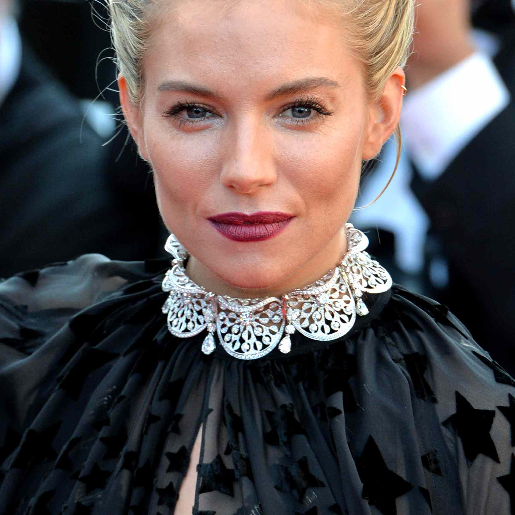 Sienna Miller with a double french-braided updo
