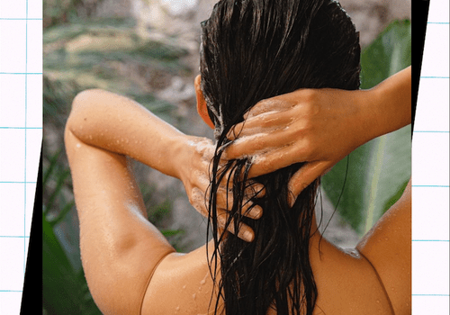 woman washing wet dark hair