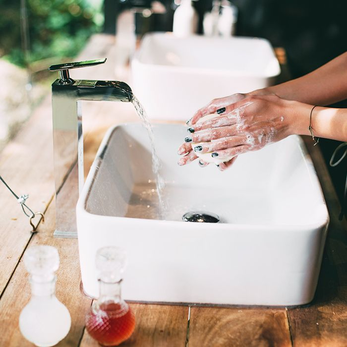 Eco friendly cleaning products: Woman washing her hands