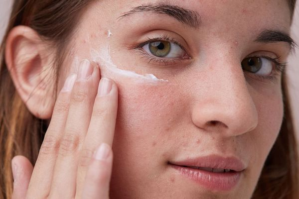 glass skincare portrait