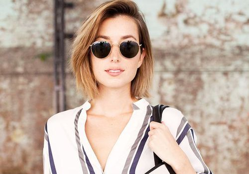 woman with short hair wearing sunglasses