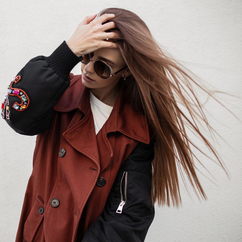 woman touching straightened hair