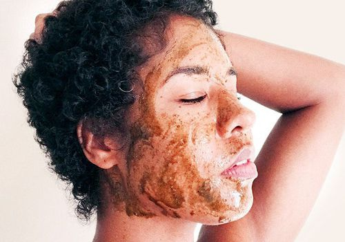 woman with short curly hair with face mask on