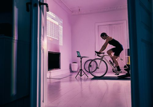 Woman on stationary bike in her living room