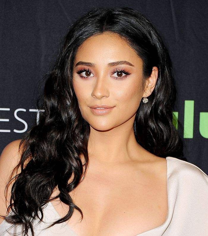 Shay Mitchell wearing her hair in polished waves
