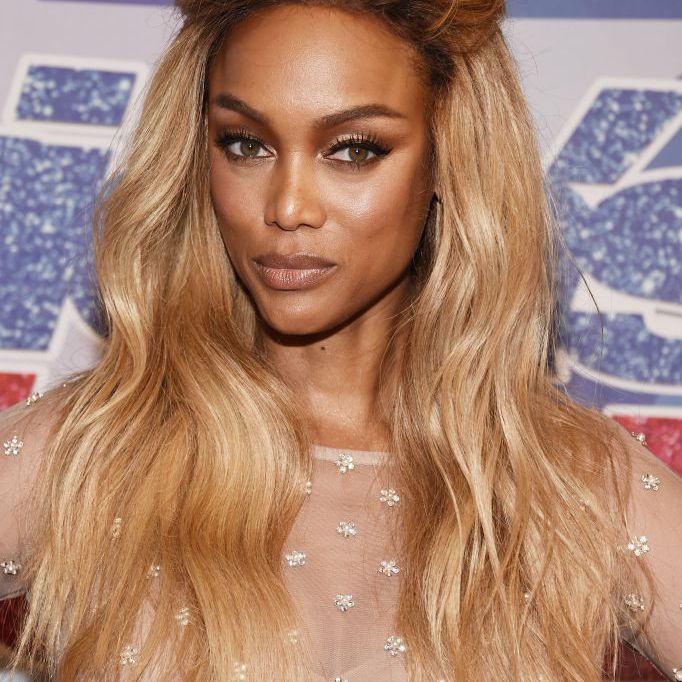 Tyra Banks long, wavy blonde hair with voumized crown and roots