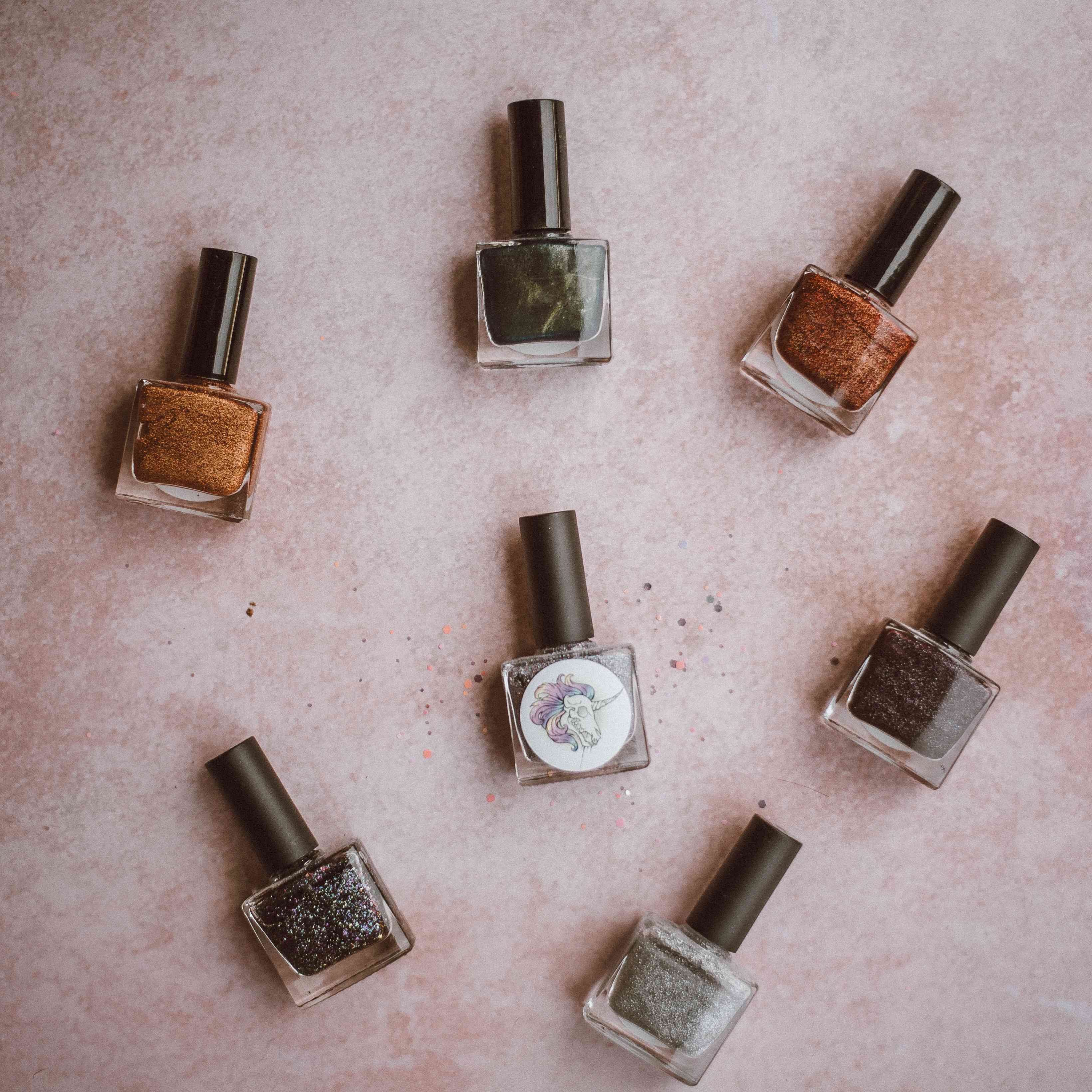 nail polish bottle scattered on carpet