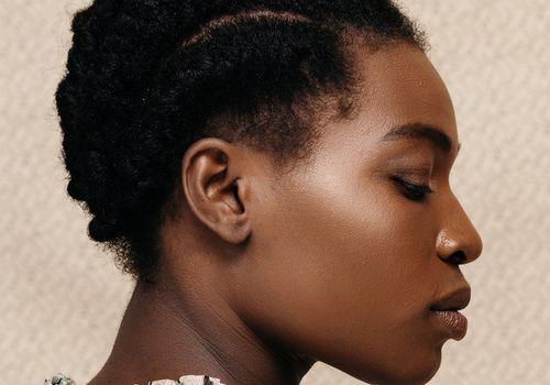 floral portrait of black femme with plaits