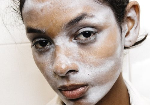woman with white powder on her face