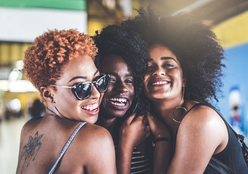 Three Black women with natural hair