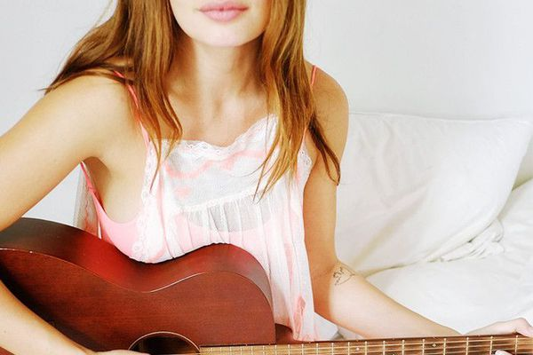 Woman holding a guitar