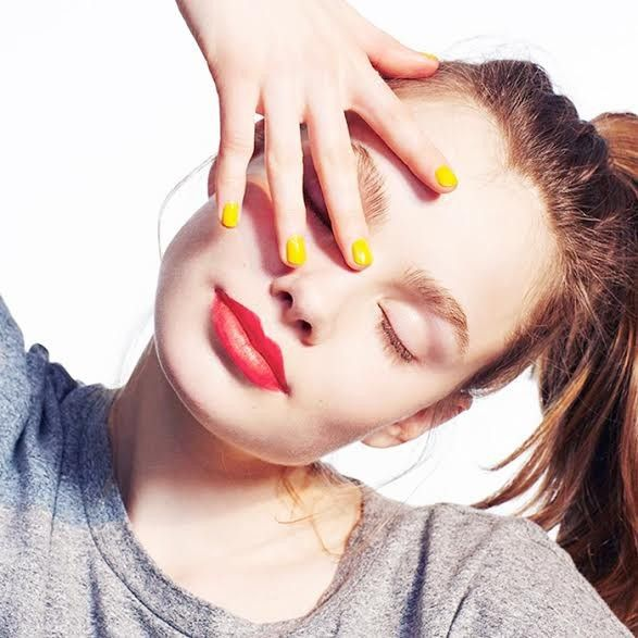 girl with red lips and yellow nails