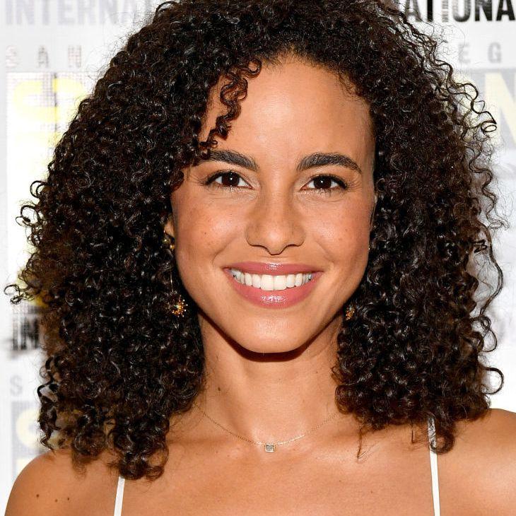 Parisa Fitz-Henley naturally curly shoulder-length hair