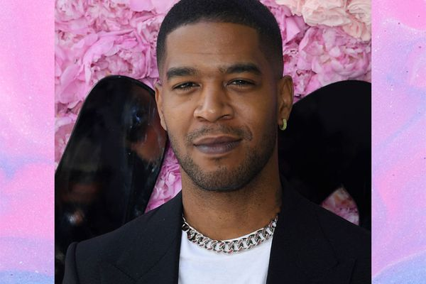 Kid Cudi in front of pink floral background