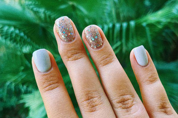 Close-Up Of Woman Hand Showing Nail Art