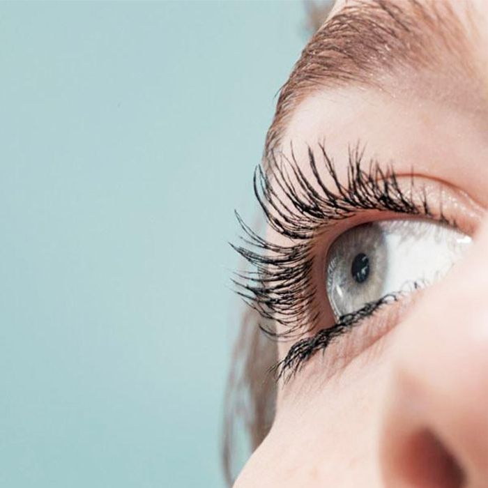 4d41659f5e7 Glossier Lash Slick review: woman with long, curled lashes