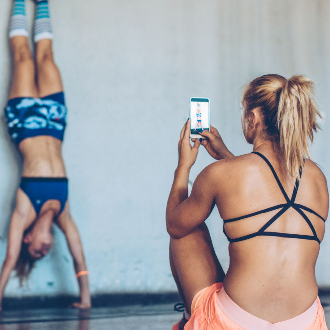 Woman taking a picture while working out