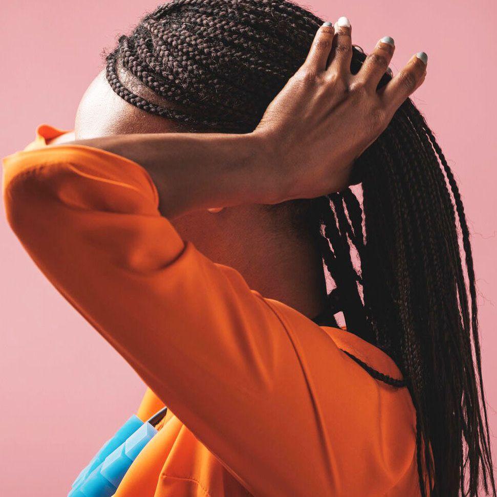 black woman holding braided hair