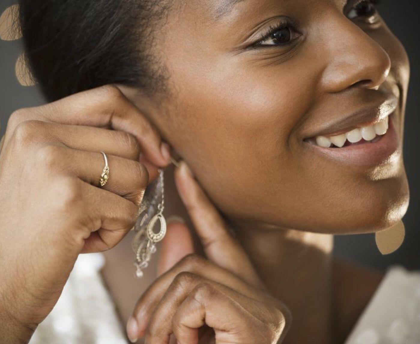Ear piercing woman